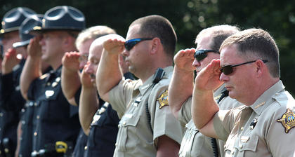 Bell&#039;s fellow law enforcement officer give him a final salute.