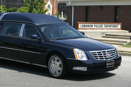 The funeral procession takes Bell past the Lebanon Police Department one last time.