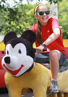 Maggie Overstreet, 11, takes a spin on one of the Zippy Land rides.