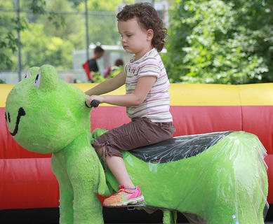 Destiny Gruber, 4, of Bradfordsville rides a frog Saturday afternoon at Old Mill Days.