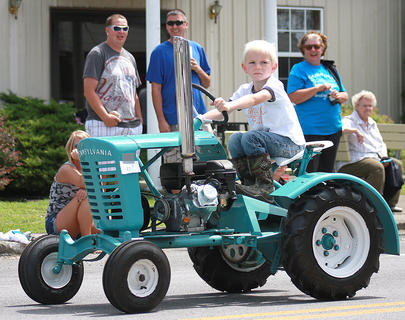 John Kirkland drove a tractor just his size in the Old Mill Days parade.