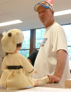 Danny Taylor walks through the collection of antique toys that were on display in the senior citizens room in the old Bradfordsville School.