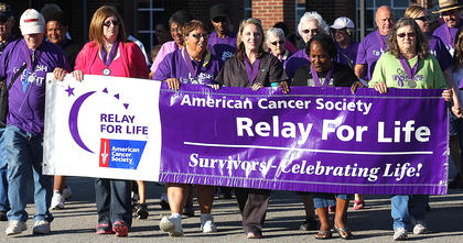 Survivors carry the Relay for Life banner for the first lap of the night. They are, from left, Michael Edberg, Rita Hughes, Mary Edna Lee, Amy Mays Thomas, Diane Adams and Joy Rawlings.