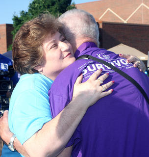 Lisa Sandusky, co-chair of Marion County's Relay for Life event, hugs one of the survivors during the survivors' ceremony.