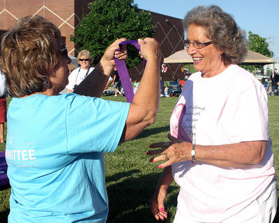 Jean Garrett flashes a big smile as she receives her survivor's medal from Lix Lawson, Marion County Relay for Life co-chair.