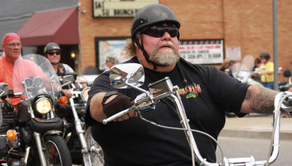 Wallace Lanham rolls out of the McB's parking lot and down W. Main Street at the start of the ride.