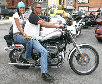 """Thomas Brown and Meredith Thomas of Campbellsville arrive at McB's. """"I wouldn't miss this for the world,"""" Brown said. This was his second time participating in the ride."""