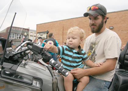 John Bickett, 23 months, sits on his father's lap and checks out a motorcycle. Jonathan Bickett of St. Mary is his father. The Drury brothers hosted their 10th annual Relay for Life Poker Run on June 16. This year's ride raised more than $4,000 for the Marion County Relay for Life (and money was still being counted on Monday). Approximately 370 people (bikers and riders) participated in this year's run. This included 215 registered bikes, which is a new record for the ride.
