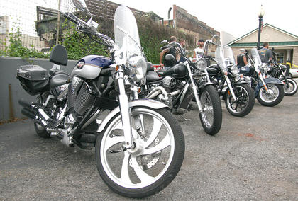 Hundreds of motorcycles filled the McB's parking lot, and several more parked in the adjacent lot and on the street.