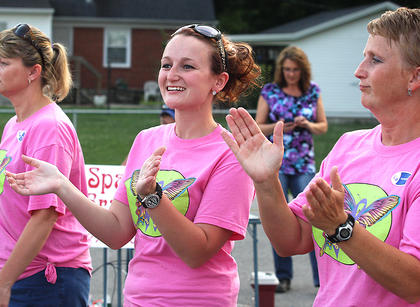 "Audri Clark and Delanna Tharp Clark clap and dance during the Relay for Life teams' lap. They are members of the ""12 Kids for a Cure"" team."
