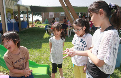 Mitsumasa Kato, 9, (far left) wins a game he was playing with Saya Kato, 5, Yuna Gorie, 8, and Yuka Kato, 11.