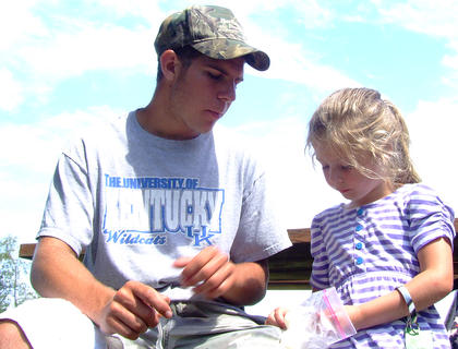 """Anthony Mattingly, 17, shares some """"ice cream in a bag"""" with his niece, Grace Mattingly, 5."""