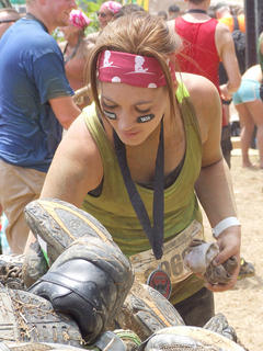 Melissa Newcomb added her shoes to the pile of donations for greensneakers.org, which cleans up used shoes and makes them to people in developing countries.
