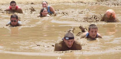 A group of warriors crawl through the mud pit.