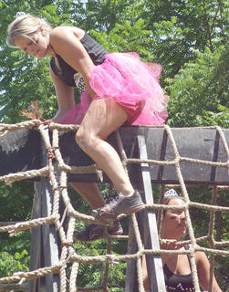 Michelle Rivera reaches the top of the Cargo Climb.