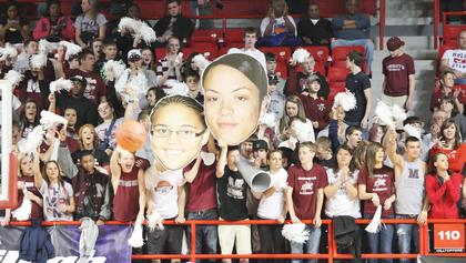 Fat Heads were all around the arena as the Lady Knights and Lady Crimsons battled for the Sweet 16 title.