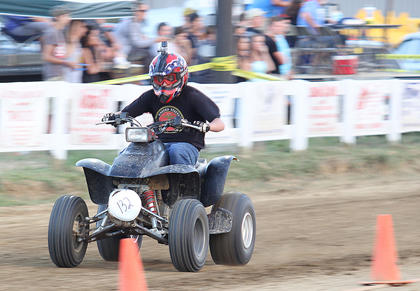 Charles Spurlock races down the track on an ATV.