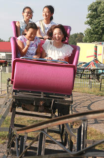 Yumiki Goto (10), left, and Rio Isomura (13) ride the front car of The Screamer, while Sukura Makoe (11), left, and Yuka Kato (12) ride in the second car July 2 at the fair.