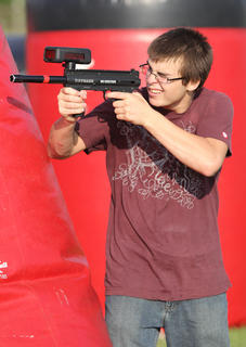 Anthony Reardon takes aim at his friends during a game of Laser Tag.