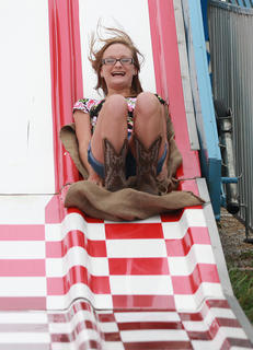 Lexis Gorley, 15, of Bradfordsville takes a trip down the big slide.