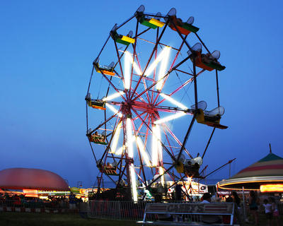 The ferris wheel is a popular ride at the fair every year and was picture perfect Friday evening after the sun set.