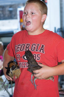 Alex Russel managed two chickens at once as he brought them from the judging table while sharing a laugh with his family.