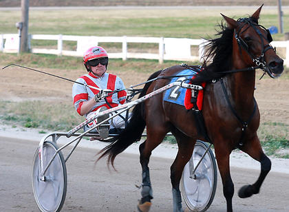 James Avritt Sr. drives Nice'N Easy in the seventh race July 3 at the Marion County Fair.