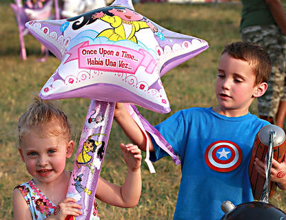 Olivia Spalding, 2, and John Lucas Richardson, 5, leave the fair with prizes in hand.