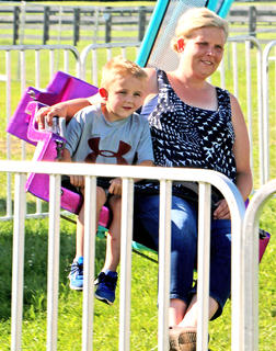 Eli Cox and his mother Therese Cox enjoy spending time on one of the rides at the Marion County Fair Saturday.