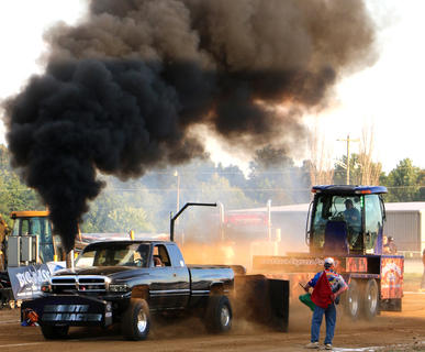 Austin Fulks drives his truck Smooth Character during the Truck and Tractor Pull event at the Marion County Fair on Saturday.
