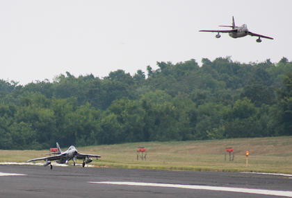 One plane lands as another makes a pass Saturday afternoon.