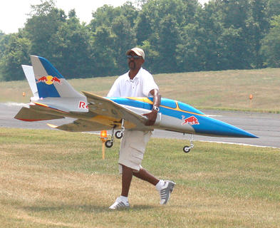 Chris Tucker of Redford, Michigan helps recover a plane that was having trouble taking off.