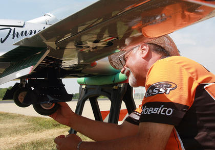 George Manning of San Bernardino, California does some work on his plane before a flight.