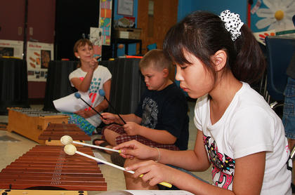 Rio Isomura practices so she can play the piece of music she just composed.