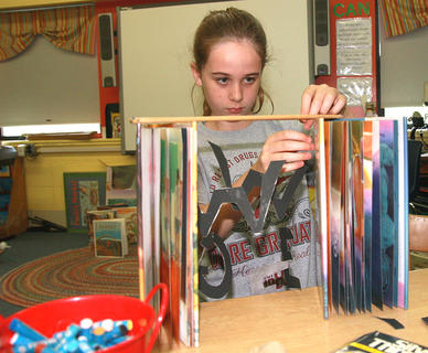 Christine Cox works on a visual arts project.
