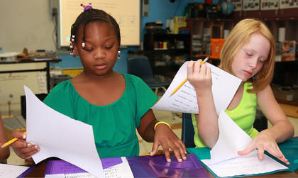 Katasia Spalding, left, and Kylee Hardin work on composing their own pieces of music inspired by the book, ÒOne Lucky GirlÓ by George Ella Lyon.