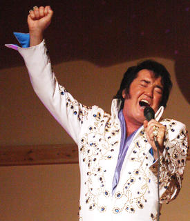 "Marion County native Eddie Miles performed his show, ""A Salute to Elvis and Country Legends"" in front of a packed Angelic Hall in Lebanon Friday and Saturday. And he'll be back to perform Aug. 9-10 and Sept. 13-14. His performance begins at 8 p.m., with doors opening at 7 p.m. Tickets are $20 in advance or $25 at the door. For more information or to purchase tickets, call the Lebanon Tourist and Convention Commission at (270) 692-0021 or visit http://www.visitlebanonky.com/events/eddie-miles-concert/. For more information about Miles, visit www.eddiemiles.com. Eddie Miles belts out a big note while singing one of Elvis Presley's hits, ""In the Ghetto."""