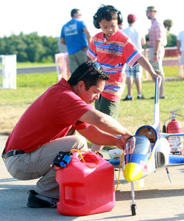 """Andy P"" Panoncillo of Muncie, Ind., works on his Red Bull inspired jet as his son, Aiden, 8, gives him a hand during Jets Over Kentucky last week at the Lebanon-Springfield Airport."