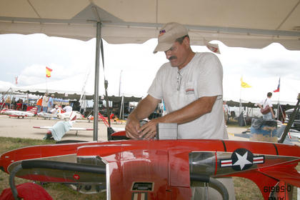 Andy Andrews of Little Rock, Ark., repairs the landing gear on his model F80 in between flights. 