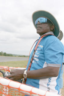 "Event organizer Lewis ""The General"" Patton operates his plane during a flight on Saturday."