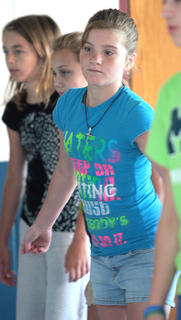 From left, Laurel Brahm, Kaylee Thomas and Chloe May practice dance steps.