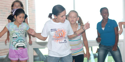 Dance instructor Brittany Taul, center, teaches some campers a few new steps. The campers are, from left, Laurel Brahm, Fernanda Reyes, Natasha Hidon and Jarie Newby.