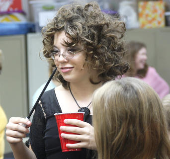 "Lauren Knott, 13, dressed as Bellatrix Lestrange, who is a Death Eater. ""The fifth book is my favorite,"" she said, as she gripped her wand."