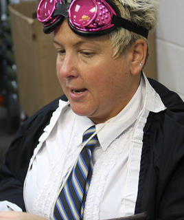 Elaine Rahn, the young adult librarian, dresses as Madam Hooch from the first Harry Potter film as she helps the children make potion necklaces.