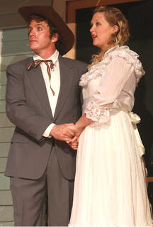 Curly McLain (G.B. Dixon) and Laurey Williams (Tegan Hanks) celebrate their wedding on Williams farm.