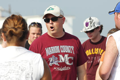 Band Director Shane Mitchell gives band members a pep talk during band camp. Also pictured are Karly Baize, Leslie Smothers and Aaron Cook.