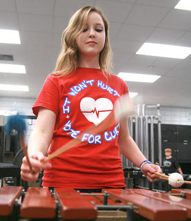 Junior Adria Whitfill practices on the marimba.