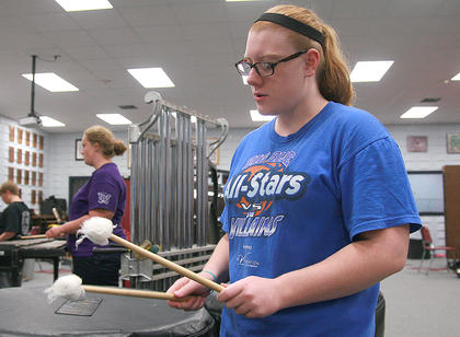 Junior Katie Cooper practices on the marimba.