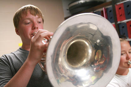 Freshmen Gavin Hasty (left) and Claire Higdon practice playing the mellophone.
