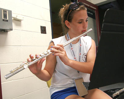 Freshman Maria Newton works on learning the music for the flute.